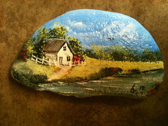 This is a rock that I picked up in Pigeon Forge several years ago while we were on vacation. It is painted with acrylic and features a country
