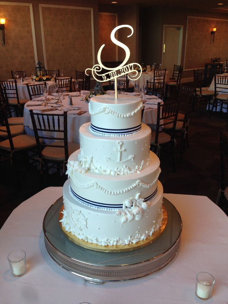 A grand Nautical themed wedding cake, inside is a rich Devils food cake filled with chocolate mousse and frosted with our custom blended buttercream. Call YOPS for a free consult, 732-530-3337