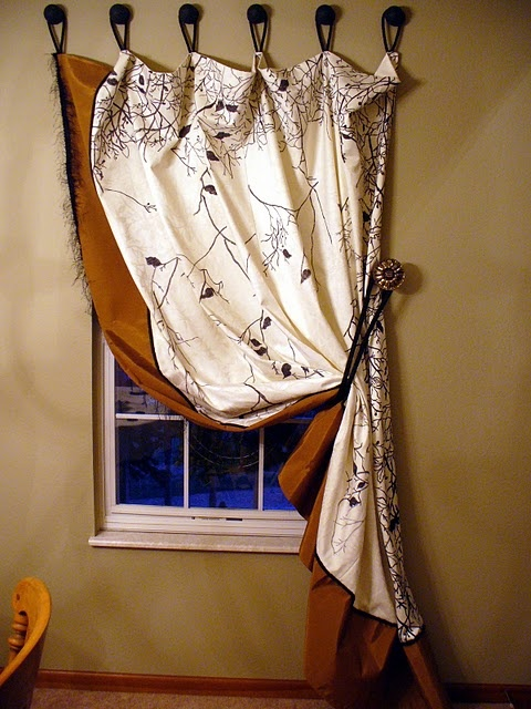 Idea for a curtain panel for the window at the top of the - Unique ways to hang curtains ...