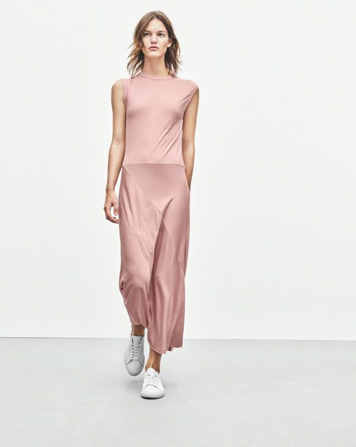 "New! Did you know you can now find out how every garment was made? Click the ""Who Made It"" Tab. <br /><br /> Sleeveless dress in tencel jersey with zip at centre back. Lined bias cut skirt in Half calf length. A sophisticated dress that combines a femin"