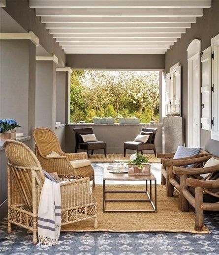 earthy covered porch.  spanish tile floors, wicker, and jute.