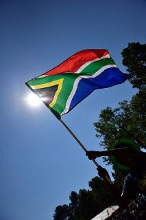 Flag of South Africa. The flag of South Africa was adopted on 27 April 1994, at the beginning of South Africa's 1994 general election, to replace the flag that had been used since 1928. The new national flag, designed by State Herald Frederick Brownell, was chosen to represent the new democracy. Three of the colours – black, green and yellow – are found in the banner of the African National Congress. The other three – red, white and blue – are displayed on the old Transvaal Vierkleur.