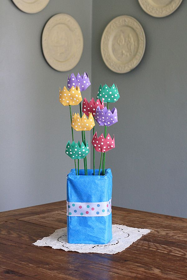 Make your own DIY centerpiece for spring with cardboard tube polka dot tulips from Crafts by Amanda. Use cardboard tubes, wooden dowels, paint, scissors and hot glue to create colorful flowers to add to your home.