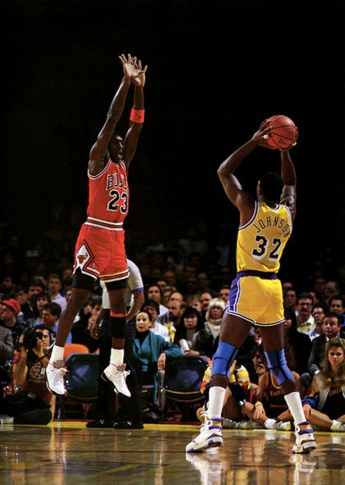 Michael Jordan in the Nike Air Jordan V defending against Magic Johnson