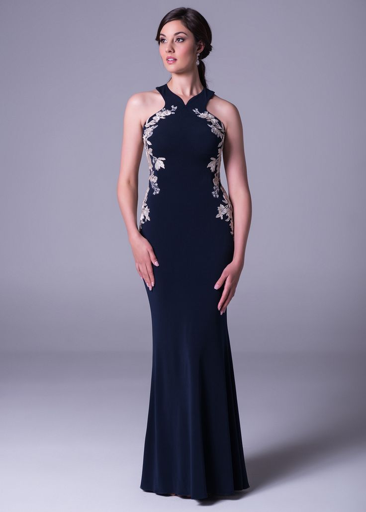 Add a fashionable twist to your #eveningdress with this cross #halterneck gown with #lace applique. Style VC5041. Click to book a free fitting in this dress, or find more online from Bride&co #southafrica stores.   #eveningdresses #navydress #bluedress #eveninggown #brideando #navybluedress