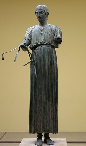 The Charioteer of Delphi (also Heniokhos, the rein-holder), is one of the best-known statues surviving from Ancient Greece, and is considered one of the finest examples of ancient bronze statues. Found in 1896 at the Sanctuary of Apollo in Delphi. It is now in the Delphi Archaeological Museum. Erected at Delphi in 474 BC to commemorate the victory of a chariot team in the Pythian Games, which were held at Delphi.