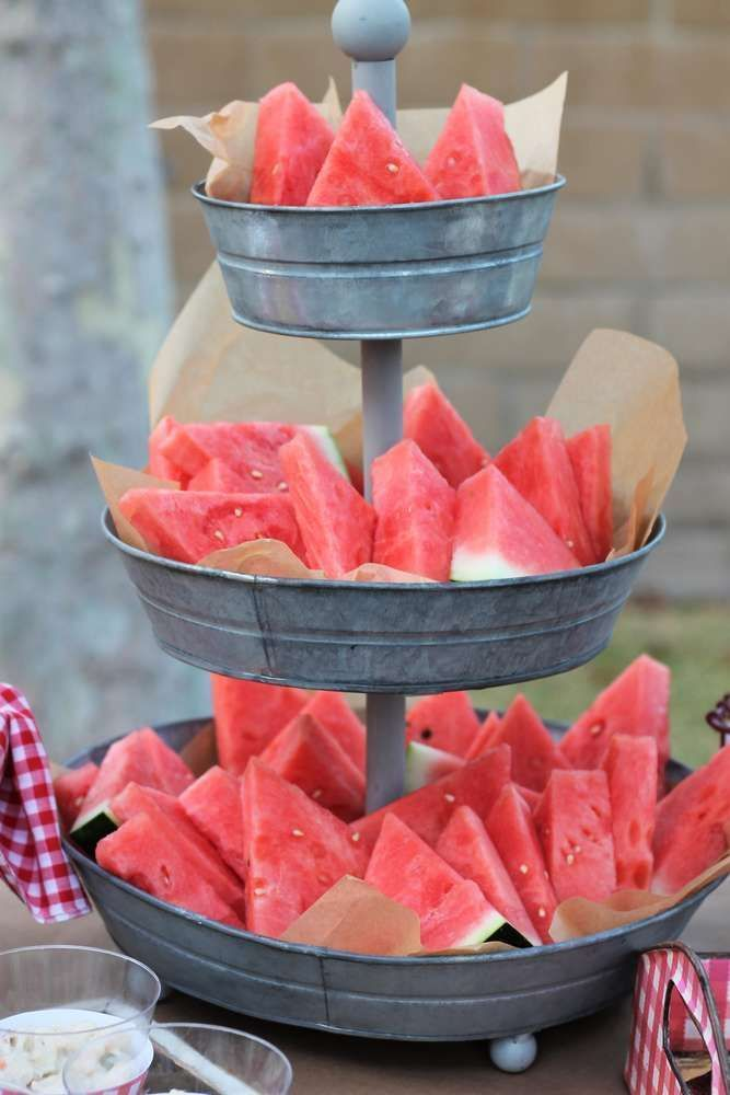 Cute watermelon serving idea for summer parties. Could also see mini corn cobs in here!
