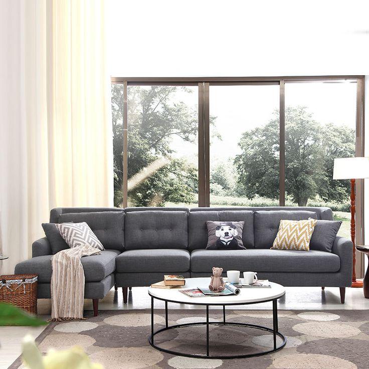 Угловой черный диван на ножках в текстильной обивке купить в гостиную можно в интернет-магазине https://lafred.ru/catalog/catalog/detail/39276977154/