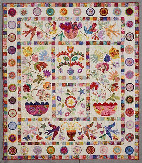 Prachtige quilt waarin de kleurige stoffen van o.a. Kaffe Fassett goed uitkomen