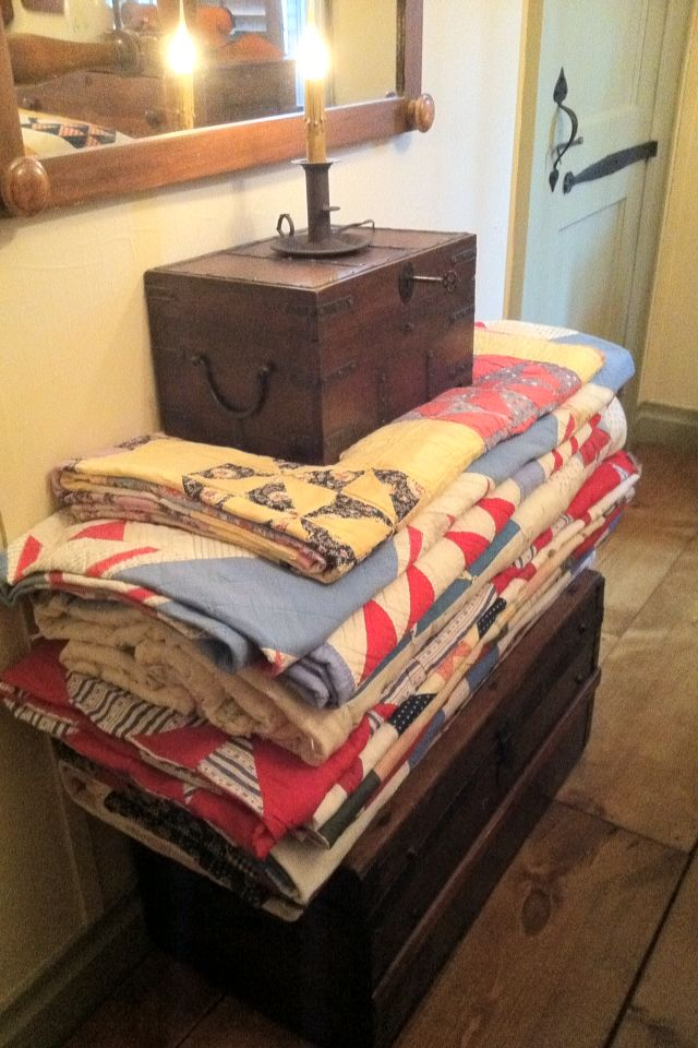 Old Quilts...prim chest & box with candle.