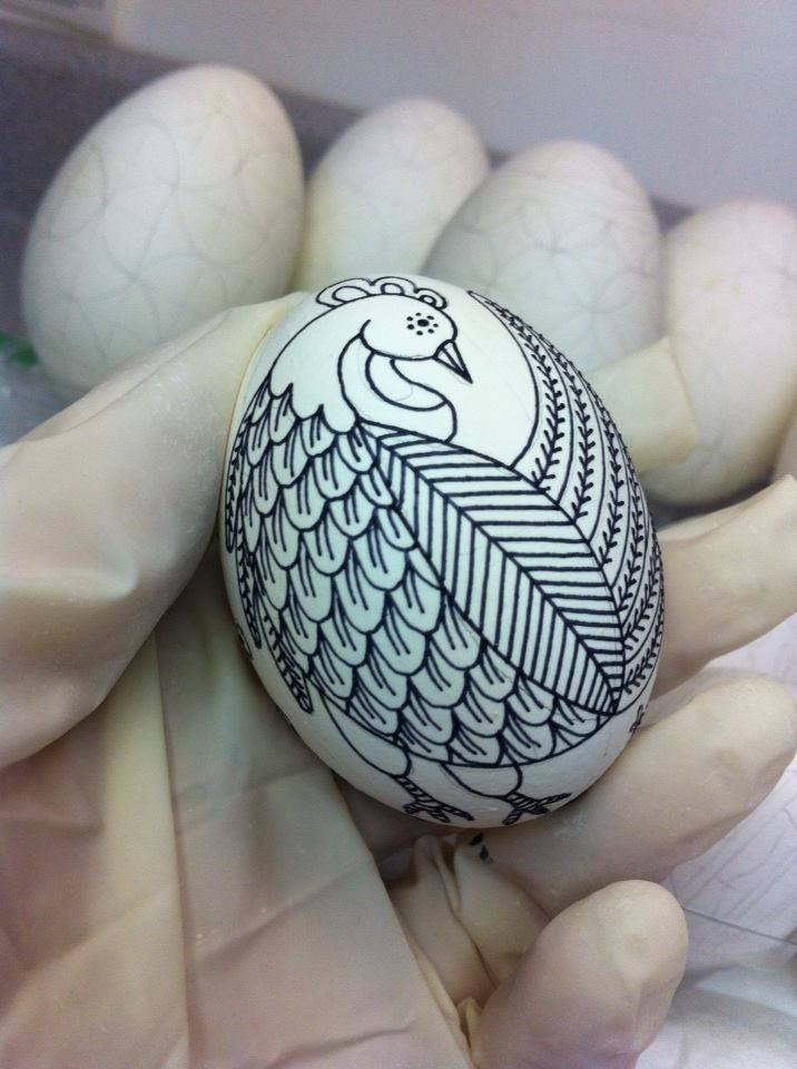 A stylized chicken on a chicken egg....the beginning of a traditional Ukrainian egg-  www.precisionartstudio.com