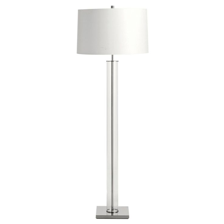 Transitional floor lamp features a columnar glass tube that surrounds a steel metal neck. Finished in polished nickel and supported by a polished nickel square foot. Topped with a white parchment drum