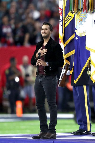 Luke Bryan Photos Photos - Luke Bryan sings the National Anthem prior to Super Bowl 51 between the New England Patriots and the Atlanta Falcons at NRG Stadium on February 5, 2017 in Houston, Texas. - Super Bowl LI - New England Patriots v Atlanta Falcons