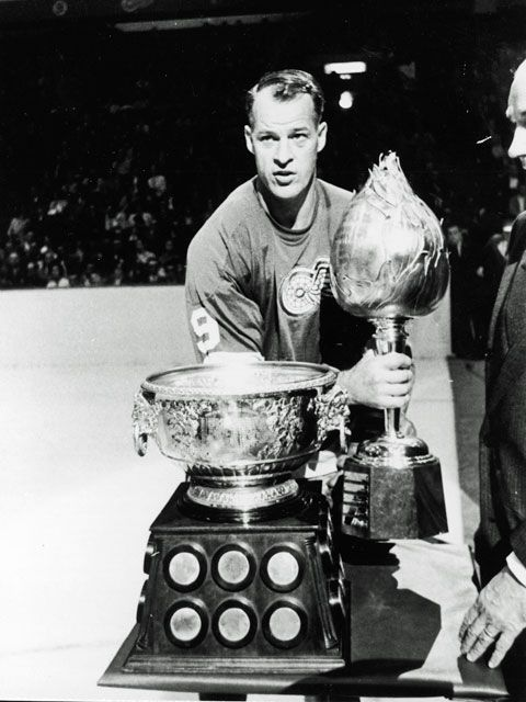 gordie howe with hart and art ross trophies