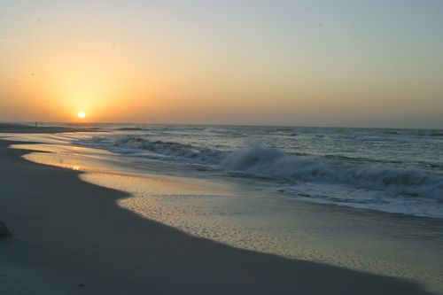 Orange Beach, AL. The Alabama gulf coast has sugar sand and beautiful emerald-green and blue water. One of the best kept secrets in the US!