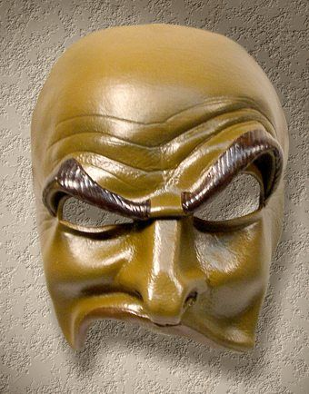this is a mask of Brighella.  This mask has Dark eyebrows and eyes.  The fore head is wrinkled and one of the eyebrows is raised in a disproving look.  This mask represents Brighella well because brighella is supposed to be funny and to have a slapstick.