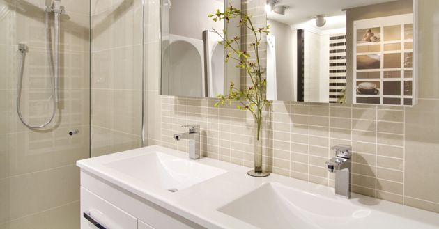 Create additional storage in the bathroom by using the space below the sink, or using mirrored cabinets. #bathroomidea #renovation #interiordesign