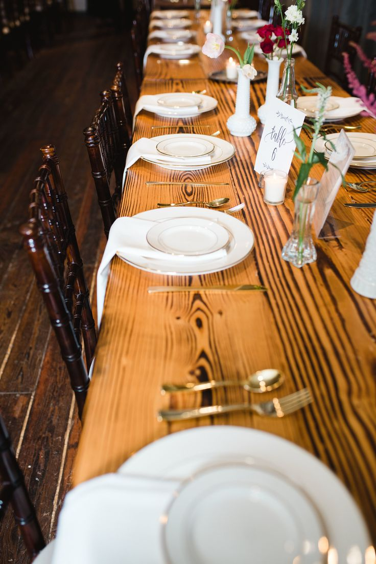 BRIK Venue   Fort Worth   Texas   Industrial   Warehouse   Historic Building   Wedding Venue   Cloud Creative Events   Alba Rose Photography   Moss Floral Design   Reception   Decor   Guest Tables   Wood Tables   Custom Tables   Chiavari Chairs   Wood Floors   Painted Brick   Greenery   Pink and Red Flowers   Candles   White and Clear Vases   Wildflowers   White and Gold Plates   Gold Flatware