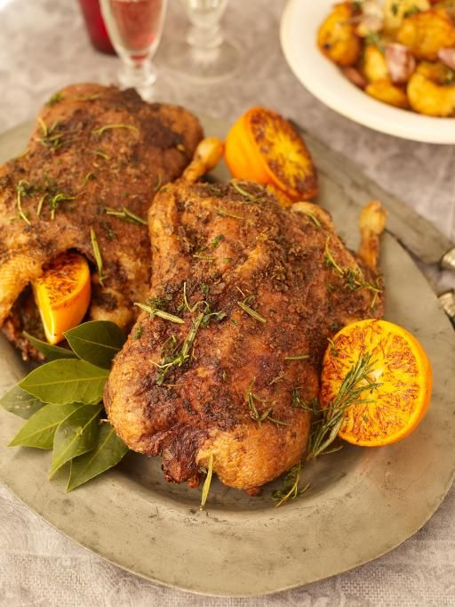 This festive duck is loaded with tasty herbs and spices, and the delicious fat is used to flavour the potatoes and port gravy.