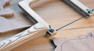 Coping Saw - Homemade coping saw constructed from surplus plywood, screws, and wing nuts.