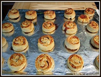 Pizza rolls, can also skewer and upright.  Serve with sauce on the side.