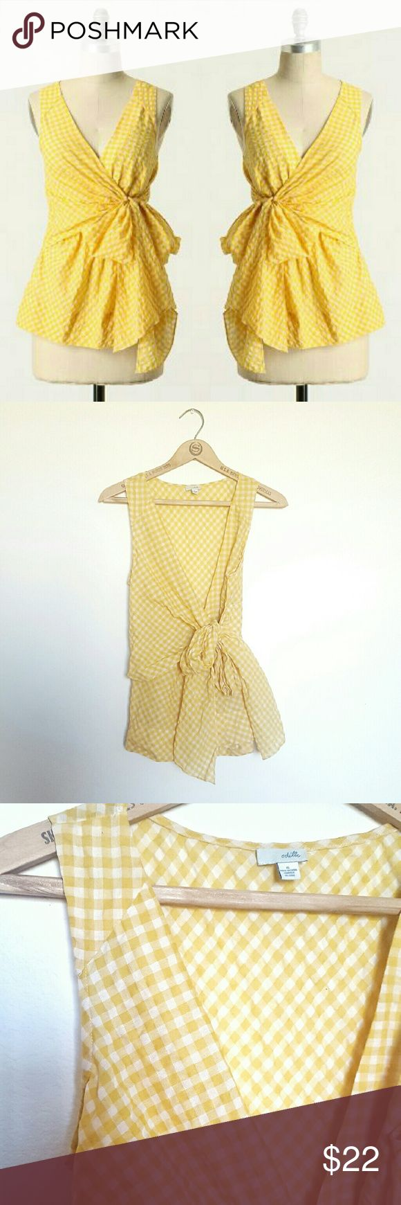 Anthropologie Yellow Gingham Sleeveless Blouse Perfect picnic attire, or fun for any sunny outfit, this yellow and white cotton sleeveless blouse features a faux wrap style sash for some extra flounce. Excellent condition and super flattering! Label is Odille. Anthropologie Tops