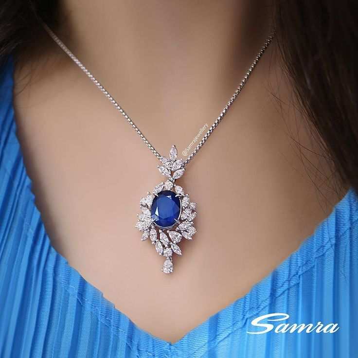 An exquisite oval cut Sapphire surrounded by pear and marquise cut Diamonds #SamraJewellery#SamraHighJewellery