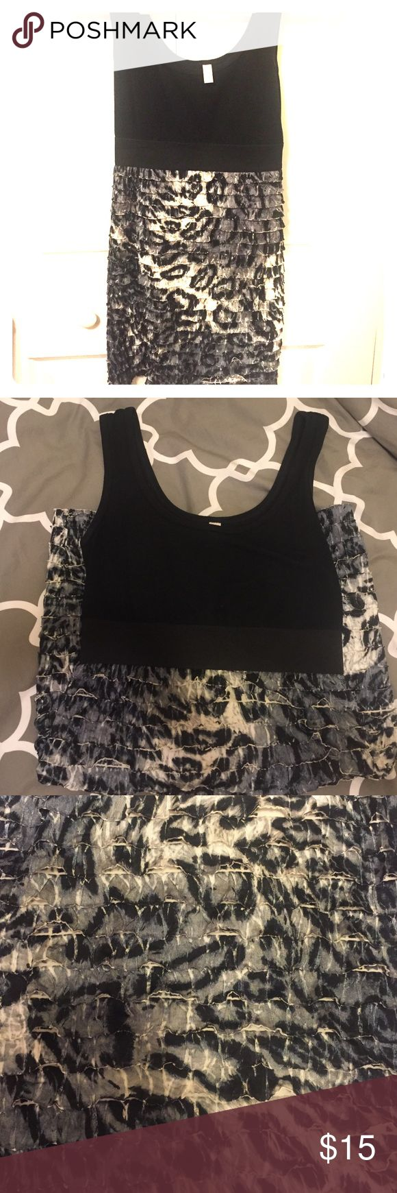 Black and animal print dress Cute form fitting black and animal print dress. Perfect for a girls night out. Dresses Mini