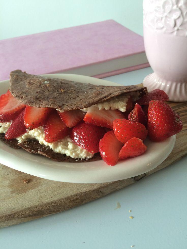 Crepe with strawberries and cheese; mug