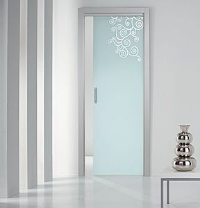 i love the idea of a frosted glass pocket door with a design etched into