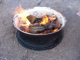 Tire rim fire pit  Been to several campgrounds that do this!  Especially with old semi wheels.