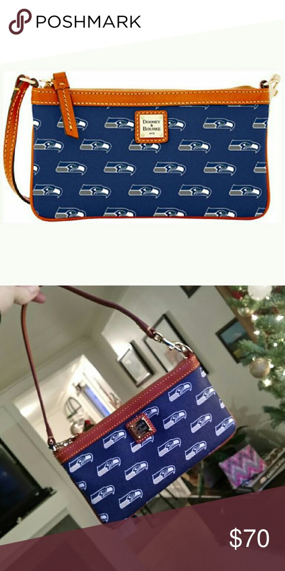 Dooney & Bourke NFL Seahawks purse/wristlet Classic Dooney  & Bourke NFL combo wristlet is perfect for your phone, cash and cards! Features a zip closure and a wrist strap. Dooney & Bourke Bags Mini Bags