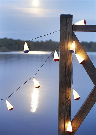 """When fully charged, this solar-powered LED light chain provides 20 hours of light SOLVINDEN solar light chain L23' 3"""". 12 Float-shape assorted colors 002.730.24 IKEA shop list"""
