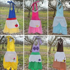 6-for-1 Princess Apron Tutorial - Make your little girl's fairy tale wishes come true by getting out your sewing materials. This 6-for-1 Princess Apron Tutorial is just what you need to dress up your daughter to look like all her favorite Disney princesses.