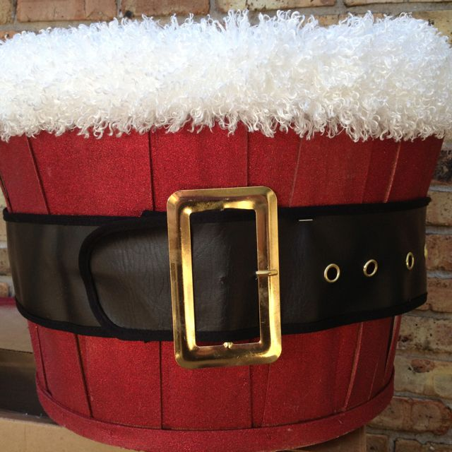 Christmas bushel basket - spray painted w dark red glitter spray, added a huge Santa costume belt & staple gunned on some fluffy white fabric trim :-)