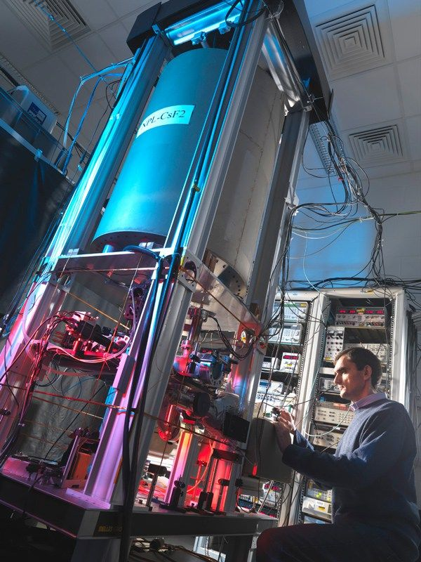 To Build the Worlds Smallest Atomic Clock Trap a Nitrogen Atom in a Carbon Cage