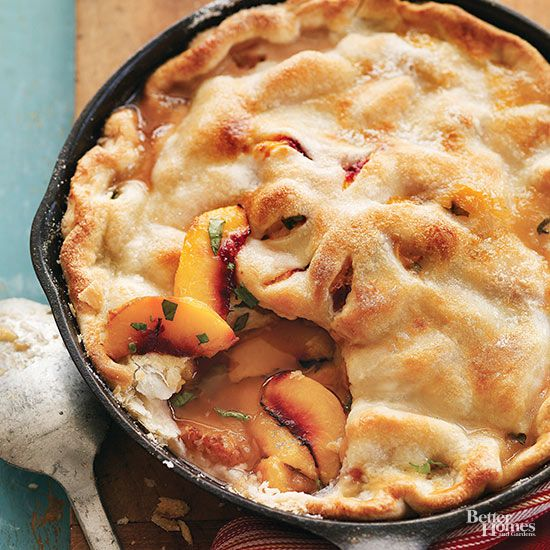 Make the most of sweet, juicy peaches in our top-notch skillet pie. Grilling the dessert in a cast-iron skillet makes the crust tender and perfectly golden brown; fresh basil adds a hit of unexpected bright flavor to the dish.