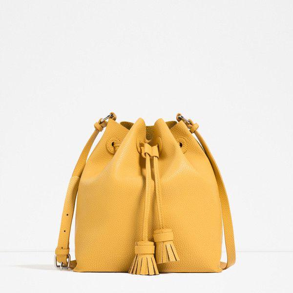 Zara Tasseled Bucket Bag ($30) ❤ liked on Polyvore featuring bags, handbags, yellow, tassel handbag, zara bag, white handbags, tassel bag and white purse