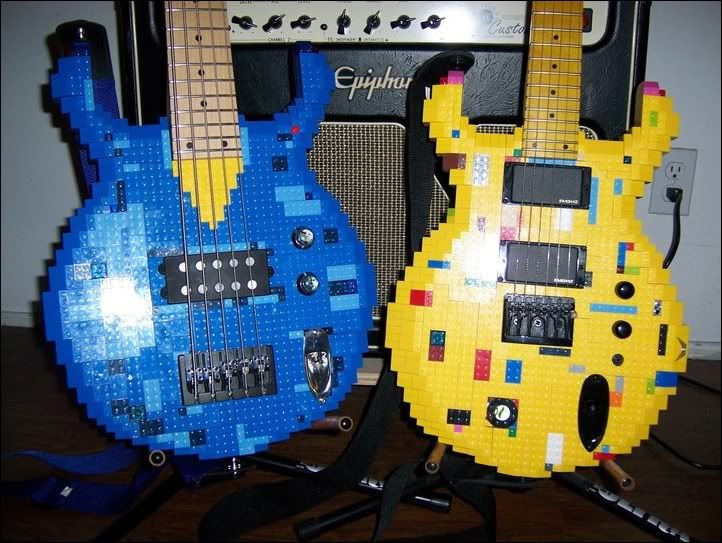 Guitar Blog: Lego guitars from Foster's Brothers. These are actual working guitars. The blue bass on the left is, I think, modeled after an Ibanez EDC bass. Their facebook: https://www.facebook.com/fosters.guitars