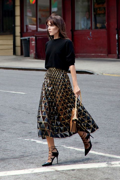 new years eve outfit idea metallic skirt black sweater style heroine square