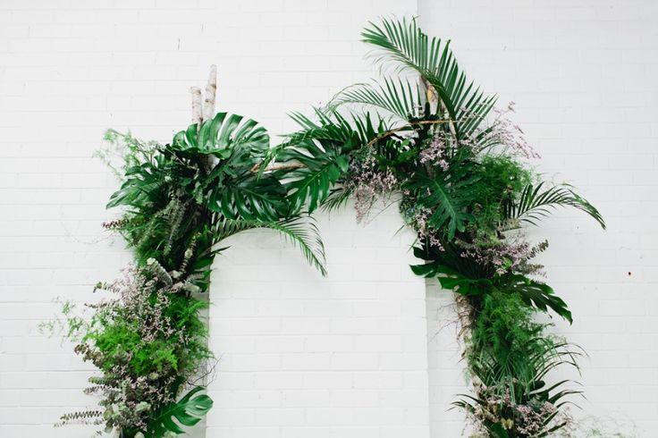 Ceremony arch heavy with foliage