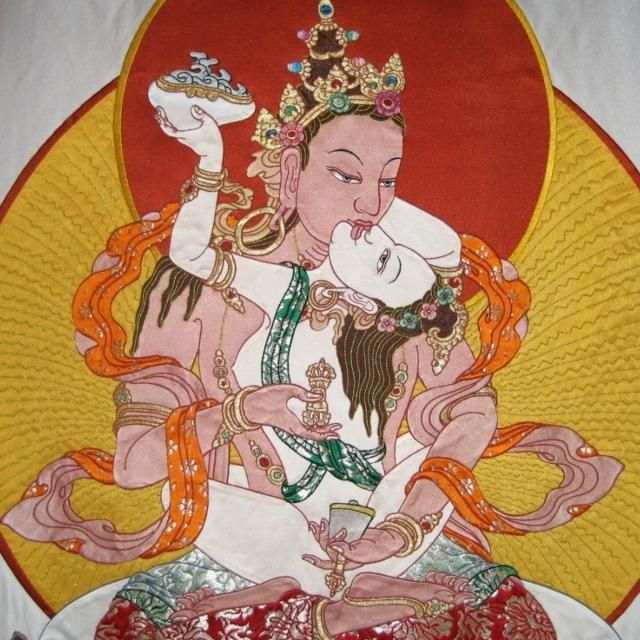 A Tibetan applique thangka painting of Dorje Sambha in union with his consort, symbolizing a tantric union of the opposites. Silk brocade, 20th Century, Tibet.