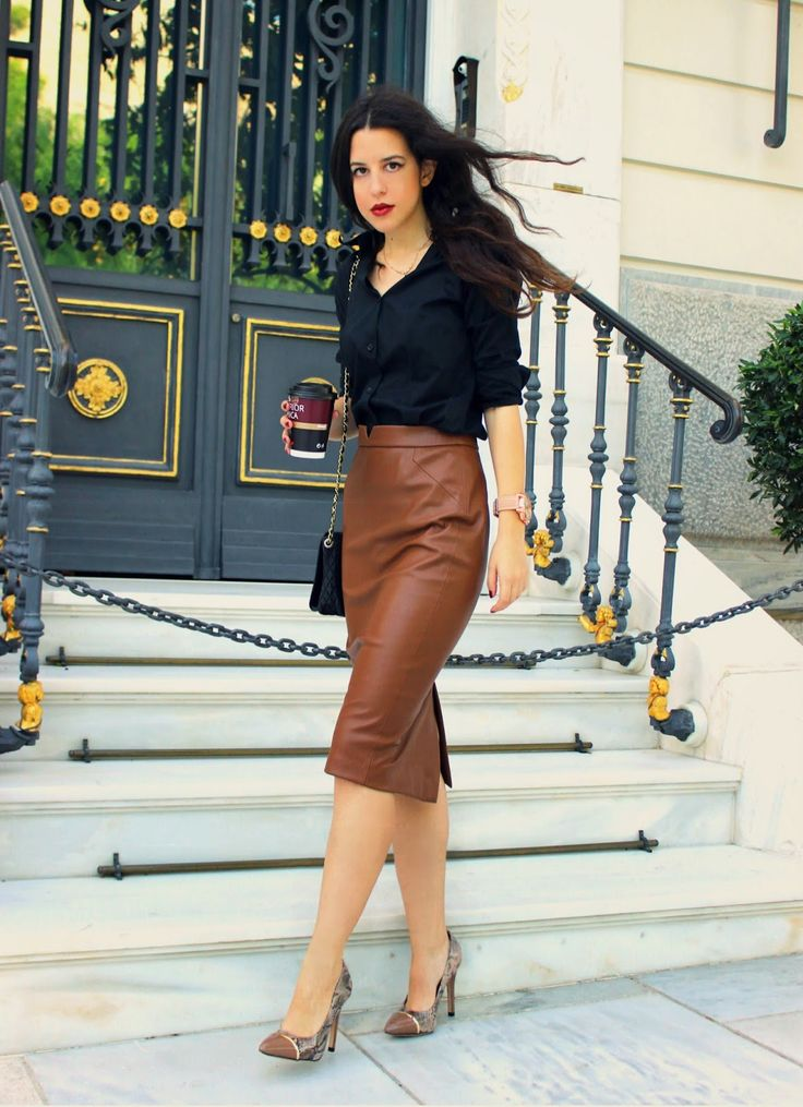 Shop this look on Lookastic:  http://lookastic.com/women/looks/black-dress-shirt-brown-midi-skirt-brown-pumps-black-crossbody-bag/4983  — Black Dress Shirt  — Brown Leather Midi Skirt  — Brown Snake Leather Pumps  — Black Quilted Leather Crossbody Bag
