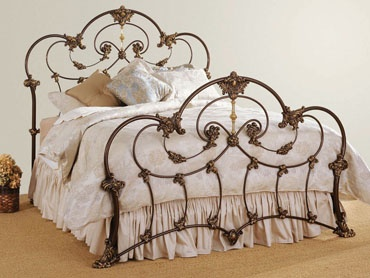 wrought iron bed brame add a splash of color to the bedding and yes