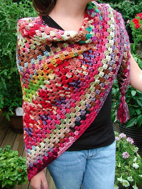 Granny Square Crochet Poncho on Ravelry here http://www.ravelry.com/projects/buckster/bucksters-crazy-insane-variegated-granny-half-gan