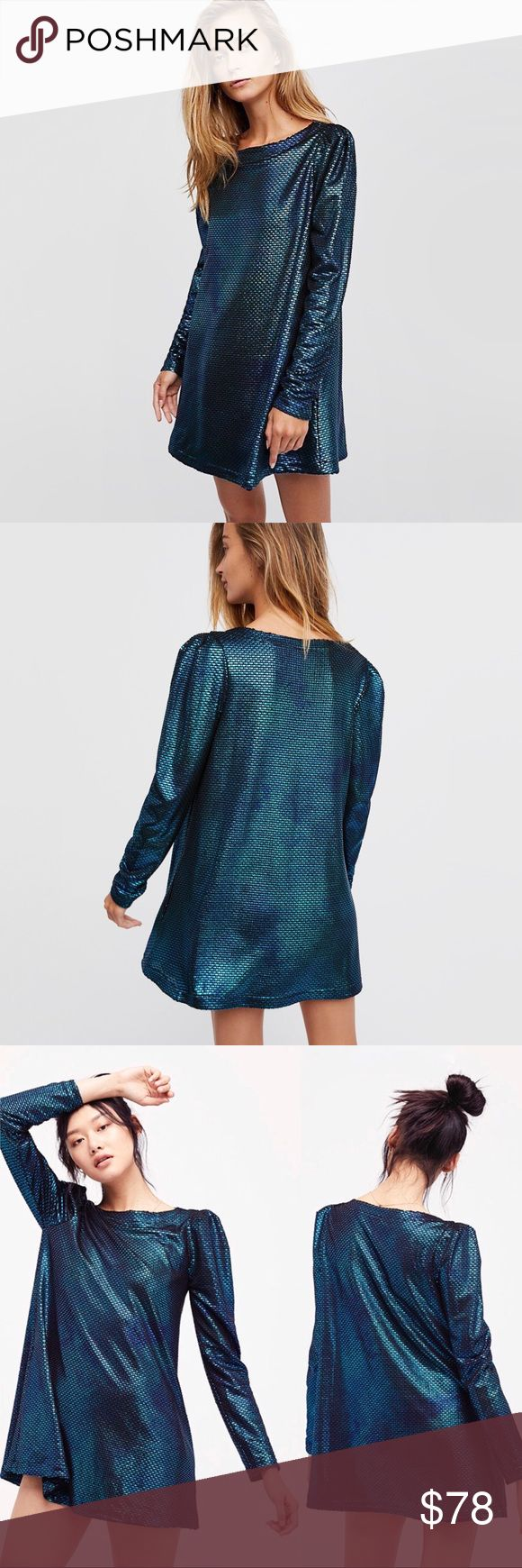 Free People Diamonds Are Forever Dress Shine on in this long sleeve metallic mini dress featuring structured shoulders and a swingy silhouette. Mermaid color scheme. Side pockets!! Free People Dresses