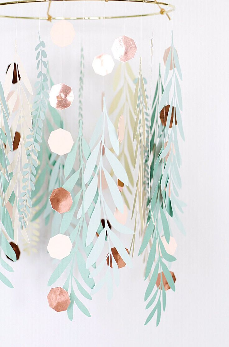 This gorgeous paper leaves chandelier is the perfect mix of natural and metallic geometric. It is a beautiful addition to any event or home.