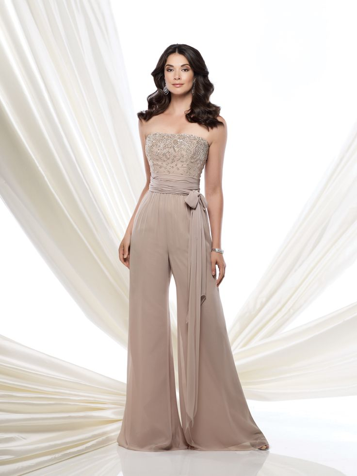 Strapless chiffon high waist jumpsuit features a bodice encrusted with hand-beading, ruched wrap tie belt at midriff, flowing wide pant legs, suitable for wedding guests and formal events. Matching shawl and removable straps included. Embellish by David Tutera earring style Amanda and bracelet style Claudia sold separately.Sizes: 4 – 20
