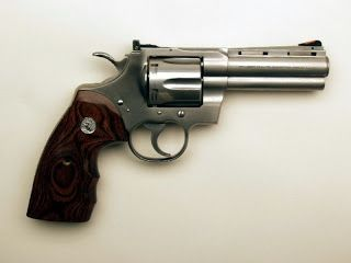 Revolver Colt Python cal 357 magnum.Loading that magazine is a pain! Get your Magazine speedloader today! http://www.amazon.com/shops/raeind