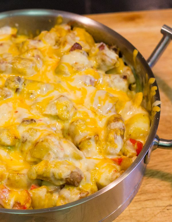 Hearty Breakfast Skillet - made with sausage, potatoes, eggs and  veggies topped with melted cheese.